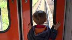 Little child looking out the train window, dreaming, get closer to destination Stock Footage