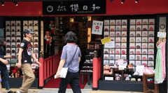 Tourists walking around souvenir shops at Dazaifu shrine in Fukuoka Stock Footage
