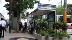 People waiting for bus and getting on bus at bus stop around Tenjin district Stock Footage