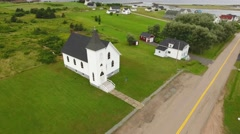 Aerial shot of a beautiful rural church on a coastline Stock Footage