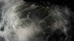 White ink moving slowly, slow motion, on black background, 4K Stock Footage