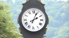 Needles motion of big clock in the mountain town  Stock Footage