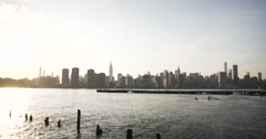 The East River Ferry floats along the NYC skyline in 4k Stock Footage