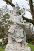 Statue of a Chinese warrior at the Buddhist temple Stock Photos