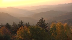 Sunrise over autumn valley and mountains, warm light landscape Stock Footage