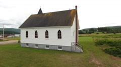Aerial shot of a beautiful rural church on the coastline Stock Footage