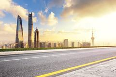 Cityscape and skyline of shanghai from empty asphalt road Kuvituskuvat