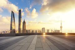 Cityscape and skyline of shanghai from empty brick floor Kuvituskuvat