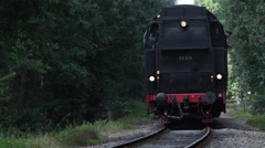 Steam locomotive pulling railroad passenger cars Stock Footage