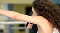 Female boxer shadow boxing on the ring, close-up Stock Footage