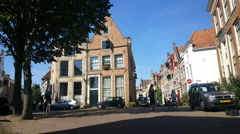 People walking in historic street of Deventer Stock Footage