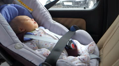 Baby child fastened security belt safety car seat Stock Footage