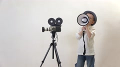 Funny child speaking to megaphone close video camera Stock Footage