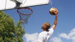 Basketball player elevates to slam dunk and score, in slow motion Stock Footage