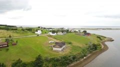 Aerial shot of small town and church on coast Stock Footage