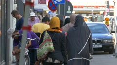 4K Tourists Muslim family in Burka Burqa headscarf shopping in European city Stock Footage