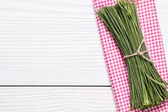 Bunch of fresh chives on a wooden cutting board, selective focus Stock Photos