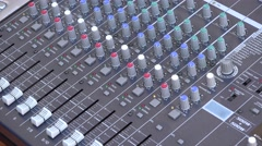 Hand adjusting sound parameters at the mixer Stock Footage