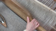 Hands working at traditional loom, beautiful handmade art Stock Footage