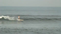 Surfer Girl is Riding on the Waves Stock Footage