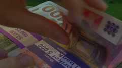 4k looking at euros and cash Stock Footage
