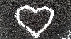 Love tea. Black tea brew heart on a white background Stock Photos