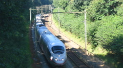 ICE High Speed Train driving past Stock Footage