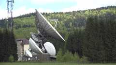 Satellite antenna station in the middle of green forest Stock Footage