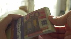4k thumbing through euros cash european Stock Footage