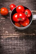 Fresh cherry tomatoes on wooden table , diet concept Stock Photos