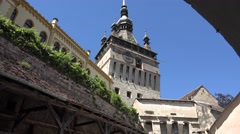 The entrance into Sighisoara medieval fortress, with its famous Clock tower Stock Footage