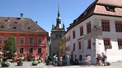 Timelapse tourists downtown Sighisoara medieval city Stock Footage