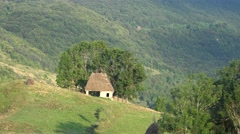 Traditional rustic barn in Transylvania mountains Stock Footage