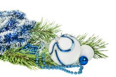 Christmas tree branch and blue ball with white glitter isolated on white Stock Photos