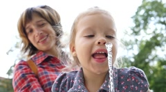 Little child girl portrait face funny drink pure water from drinking fountain Stock Footage