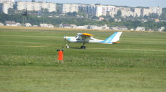 Old airplane taking off. Sport plane with propeller rides across the field Stock Footage