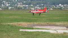 Small red airplane before take-off. Old Plane at the Airport. Stock Footage