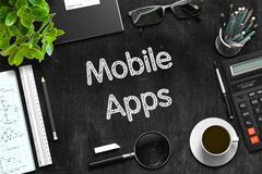 Mobile Apps - Text on Black Chalkboard. 3D Rendering Stock Illustration
