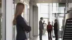 4K Portrait smiling successful businesswoman in large modern office building Stock Footage