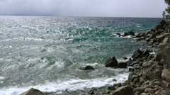 Big waves roll into the rocky shores of Lake Tahoe in the Sierra Nevada Stock Footage