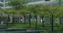 View of picturesque garden with fountain against modern building. Kuala Lumpur Stock Footage
