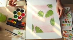 A young woman draws a pattern. Time lapse Stock Footage