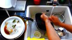 A lot of dirty dishes in the white sink in the kitchen Stock Footage