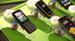 Mobile phones on a display stand in a shop Stock Footage