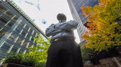 Businessman in the city looking up at skyscrapers Stock Footage