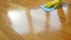 Parquet. Cleaning wooden floor.  Stock Footage