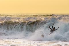Clumsy surfer fail Stock Photos