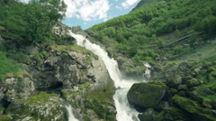 Waterfall in the mountains - wild scenery, Norway Stock Footage