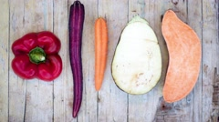 Stop motion vegetables on a flat lay  Stock Footage
