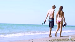 Couple Is Walking On The Beach Stock Footage
